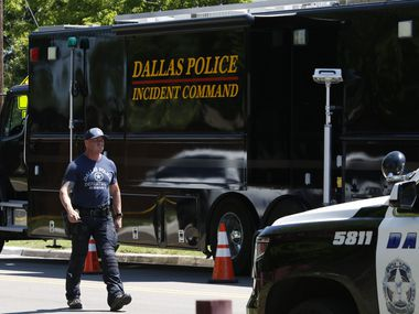 A Dallas SWAT officer walks near the scene of home on Highcrest Drive after a murder-suicide early Monday morning on May 18, 2020. Dallas officers responded to a domestic violence call in the 500 block of Highcrest Drive in Dallas. (Irwin Thompson/Staff Photographer)