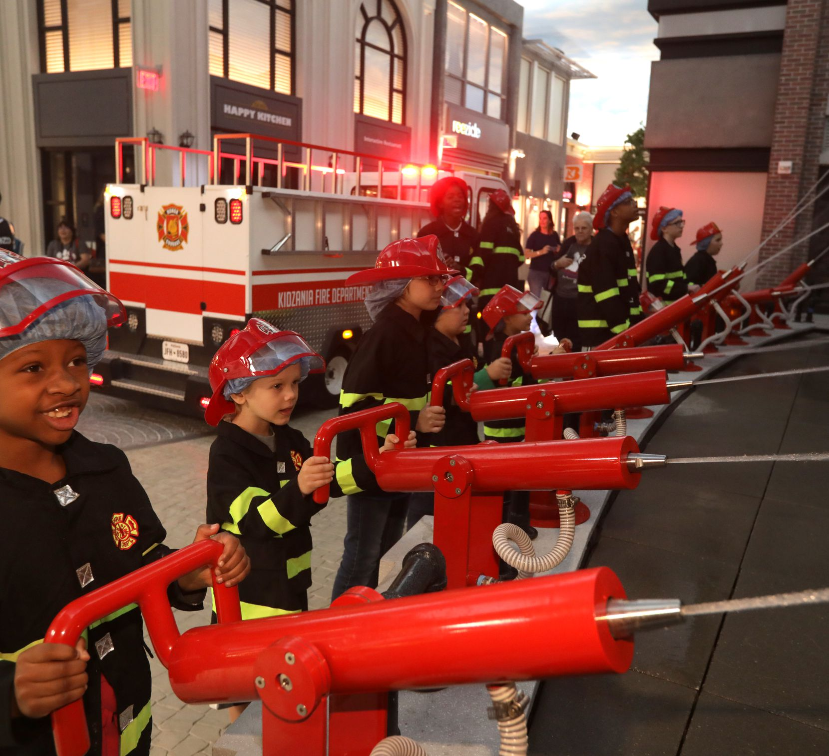Children play as firefighters at Stonebriar Centre's KidZania, an interactive entertainment venue for kids in Frisco.