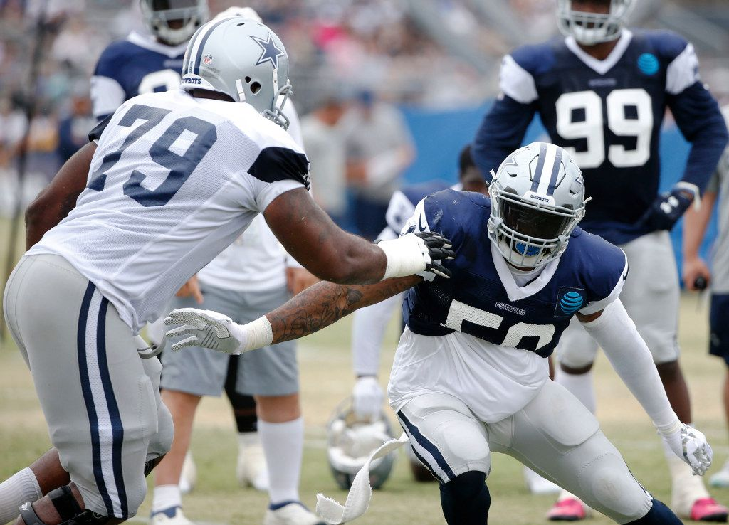 Dallas Cowboys defensive end Damontre Moore (58) works on getting past Dallas Cowboys offensive tackle Chaz Green (79) in a drill during the afternoon practice at training camp in Oxnard, California on Saturday, July 29, 2017. (Vernon Bryant/The Dallas Morning News)