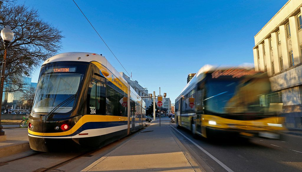 A DART bus passes by the Dallas Streetcar at the Reunion Station stop in Dallas, Tuesday, Jan. 23, 2018.