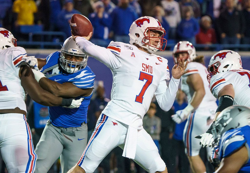SMU quarterback Shane Buechele (7) throws a pass during the first half of an NCAA football game against Memphis at Liberty Bowl Memorial Stadium on Saturday, Nov. 2, 2019, in Memphis, Tenn. (Smiley N. Pool/The Dallas Morning News)