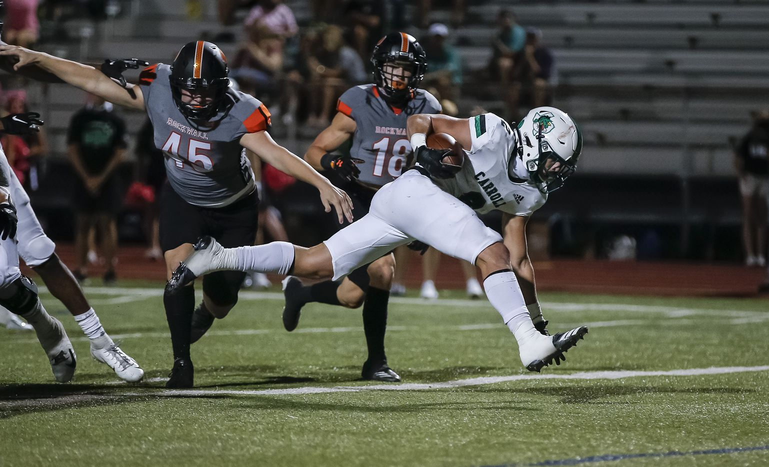 Southlake Carroll sophomore running back Owen Allen (2) scores a touchdown as Rockwall senior defensive end Caden Brown (45) and senior defensive back Kade Welcher (18) defend during the first half of a high school football game at Wilkerson-Sanders Stadium in Rockwall, Thursday, October 8, 2020. (Brandon Wade/Special Contributor)