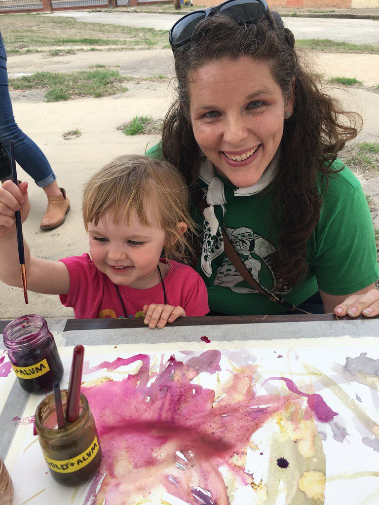 Kara Wigzell, 2, and her mother, Katie O'Brien, of Dallas paint with natural dyes.