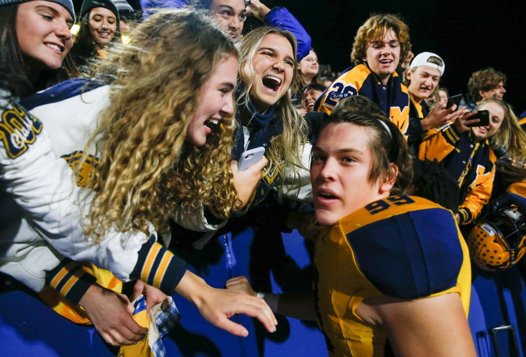 McKinney's Cavan Natal (99) celebrates with fans following their win over McKinney Boyd in a high school football matchup at McKinney ISD Stadium on Friday, Nov. 8, 2019 in McKinney, Texas. (Ryan Michalesko/The Dallas Morning News)