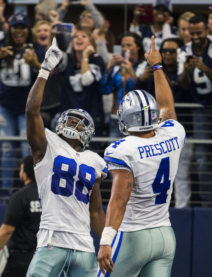 Dallas Cowboys quarterback Dak Prescott (4) and wide receiver Dez Bryant (88) celebrate a touchdown during the fourth quarter of their game against the Baltimore Ravens on Sunday, November 20, 2016 at AT&T Stadium in Arlington, Texas.