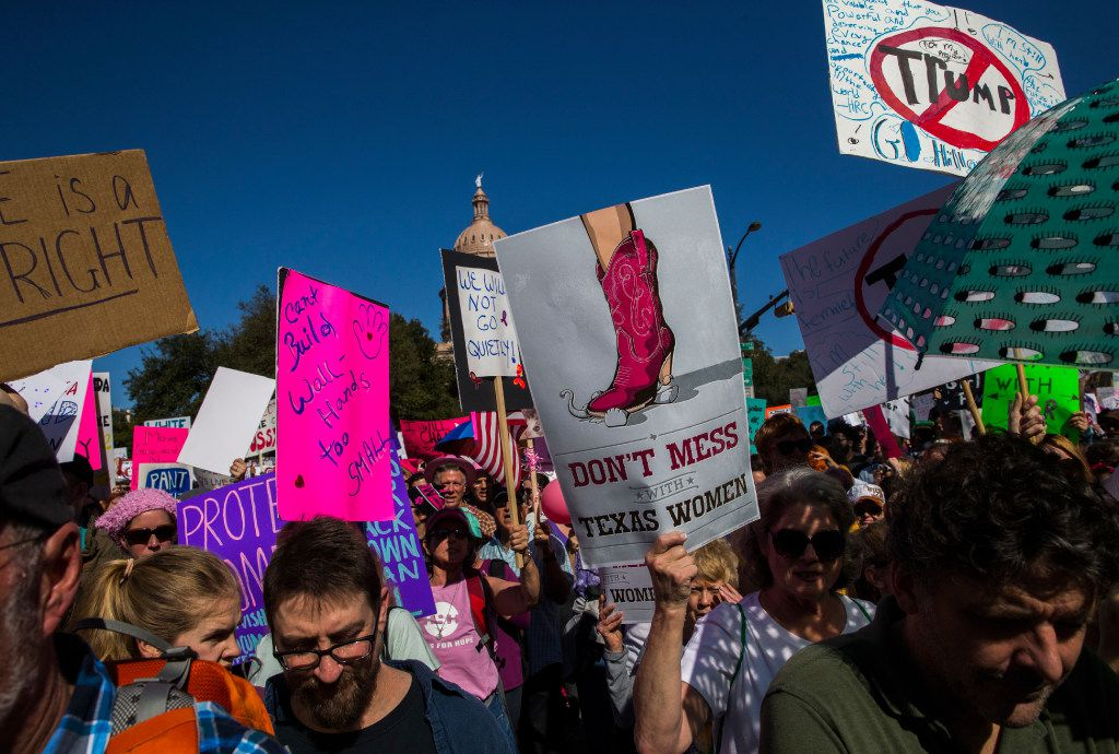 Demonstrators march on Congress Avenue near the Texas state capitol during the Austin Women's March on Saturday, January 21, 2017 in Austin. The Austin event was held in solidarity with the Women's March on Washington. (Ashley Landis/The Dallas Morning News)
