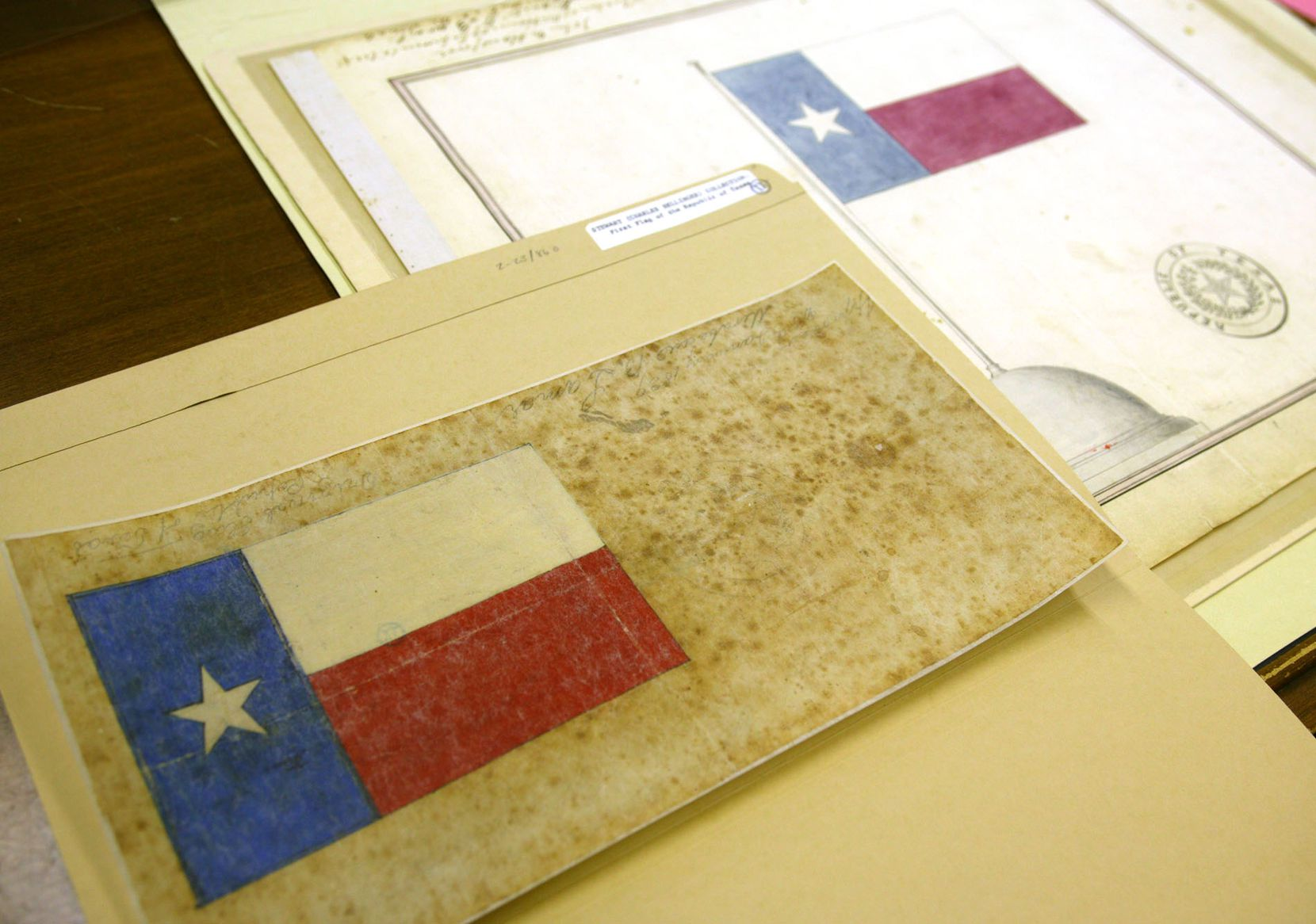 Two historic sketches by Charles B. Stewart and Peter Krag have been at the center of a debate over who was the original designer of the Texas flag.