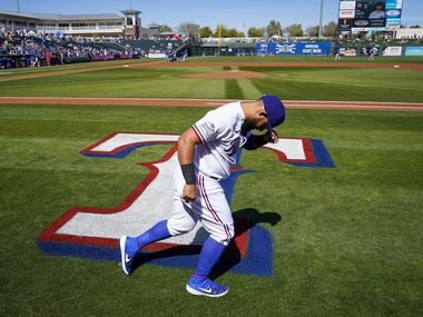 Texas Rangers second baseman Rougned Odor warms up before of a spring training game against the Chicago Cubs at Surprise Stadium on Thursday, Feb. 27, 2020, in Surprise, Ariz.