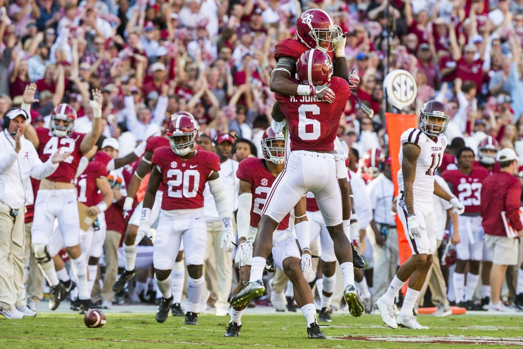 Alabama defensive back Marlon Humphrey (26) celebrates with defensive back Hootie Jones (6) after intercepting a pass intended for Texas A&M wide receiver Josh Reynolds (11) during the first half of an NCAA college football game, Saturday, Oct. 22, 2016, in Tuscaloosa, Ala. (Smiley N. Pool/The Dallas Morning News)