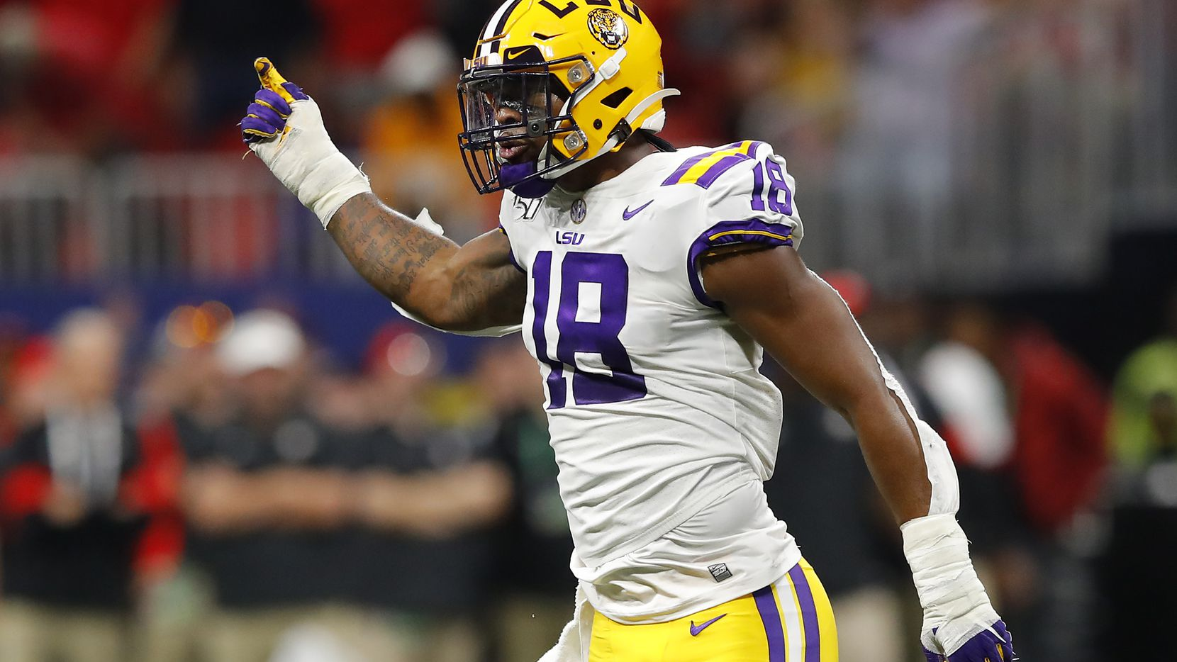 ATLANTA - DEC. 7: LSU pass rusher K'Lavon Chaisson (18) is pictured in the first half against Georgia during the SEC Championship at Mercedes-Benz Stadium on Dec. 7, 2019, in Atlanta.