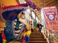 A large calavera decorates the stairwell at the State Fair of Texas this year. Grand Prairie will host its own Dia de los Muertos celebration on Saturday.