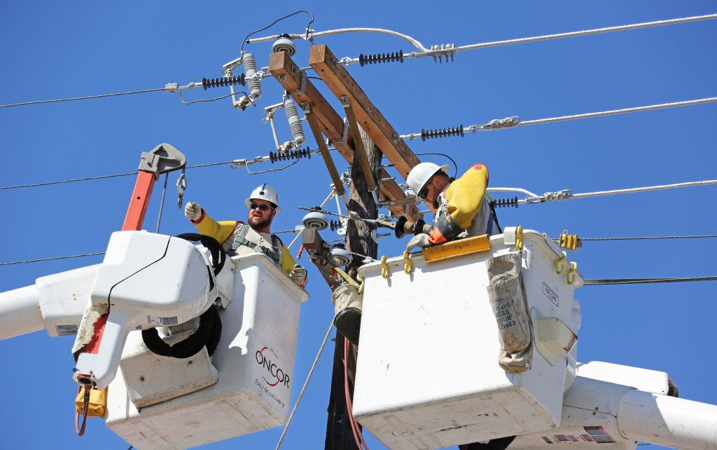 Oncor Electricity Delivery crews work along Canton Street near downtown Dallas in 2016.