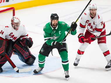 Dallas Stars left wing Jamie Benn (14) looks for an assist between Carolina Hurricanes goaltender Petr Mrazek (34) and defenseman Jaccob Slavin (74) during the third period of an NHL game between the Dallas Stars and the Carolina Hurricanes on Tuesday, February 11, 2020 at American Airlines Center in Dallas.