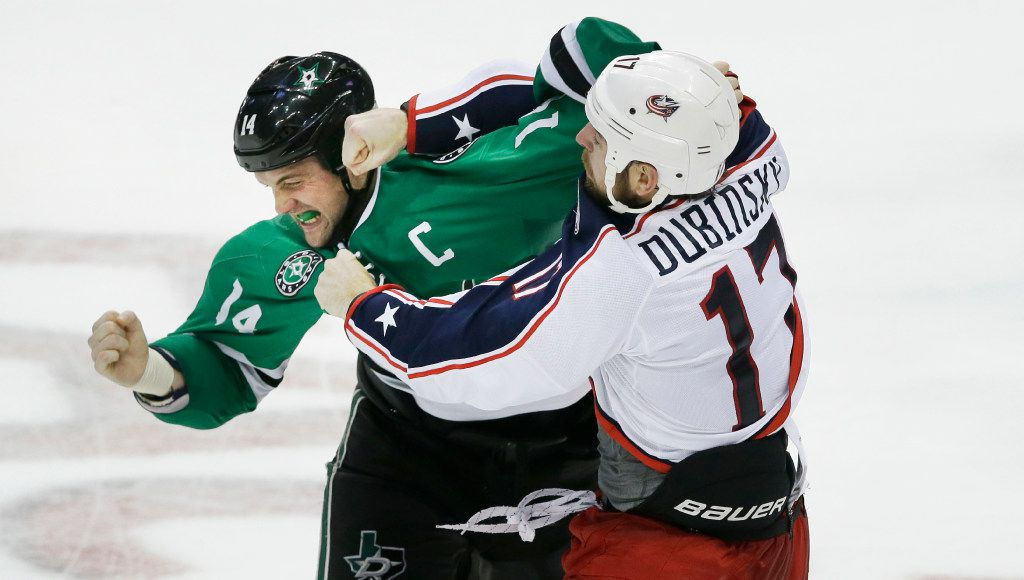 Columbus Blue Jackets center Brandon Dubinsky (17) and Dallas Stars left wing Jamie Benn (14) fight during the second period of an NHL hockey game Saturday, Oct. 22, 2016, in Dallas. (AP Photo/LM Otero)