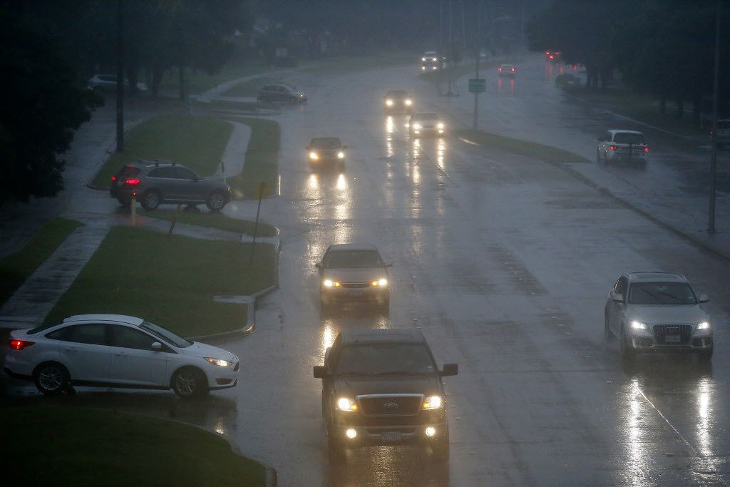 Commuters navigate Coit Road north of 15th Street in Plano in heavy rain in this file photo. Heavy rains lead to flooding in much of the region recently.