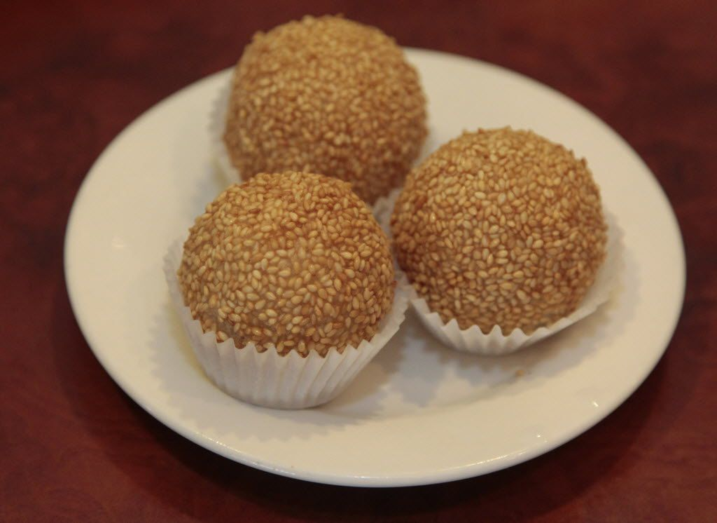 Sesame balls, a dessert item that's served warm. A server will usually offer to snip these open, revealing red bean paste inside. The good ones are hot and not too oily, with a good balance of nicely sweet bean paste.
