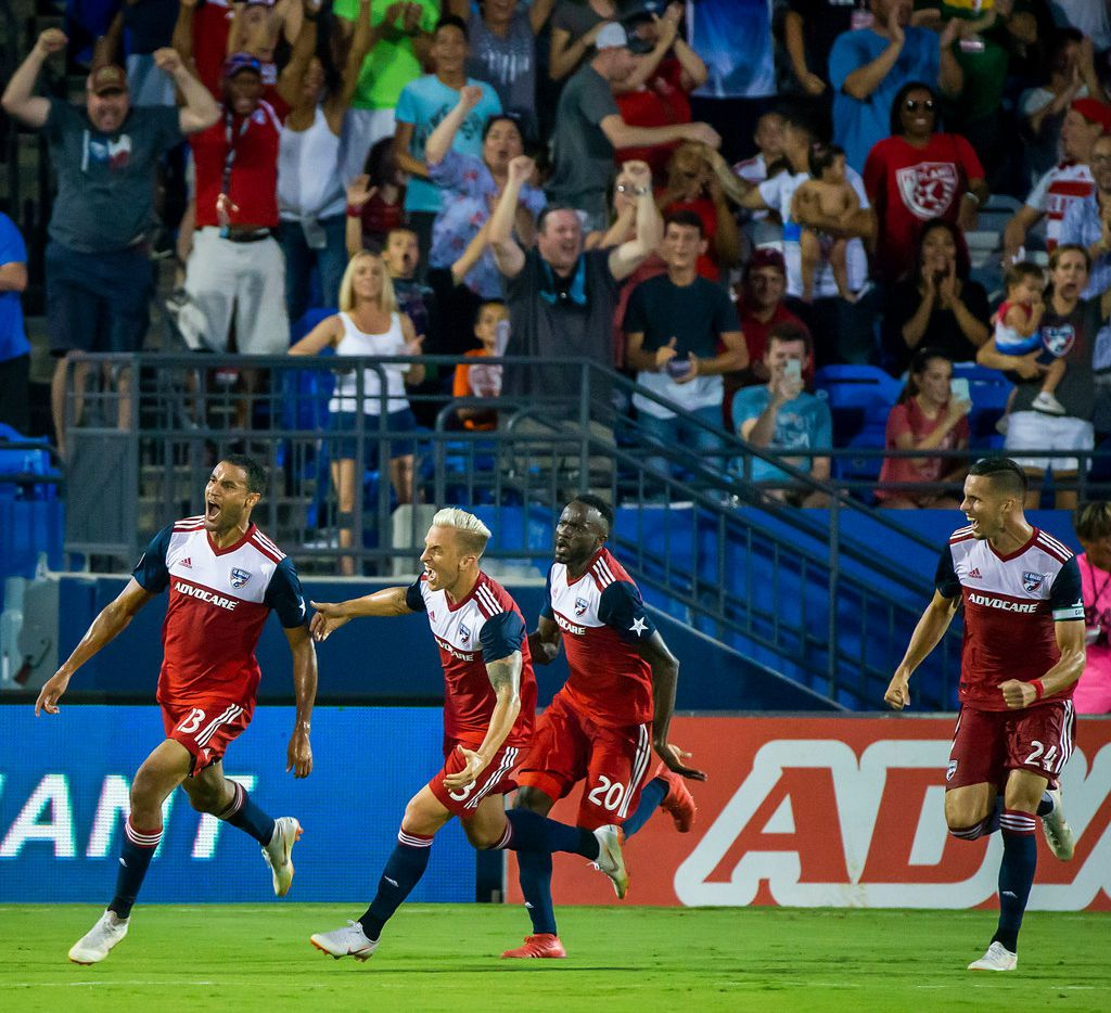 FC Dallas forward Tesho Akindele (left) celebrates with defender Reto Ziegler (3), forward Roland Lamah (20) and defender Matt Hedges (24) after scoring the game-winner in the 88th minute during the second half against Atlanta United on Wednesday, July 4, 2018, in Frisco, Texas. FC Dallas won the game 3-2.  (Smiley N. Pool/The Dallas Morning News)