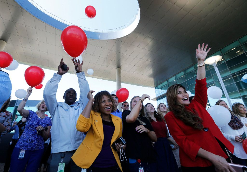 Wotsa Koutoglo (center) and Lenie Tumminia watch as balloons are released by employees after Jim Lentz, CEO of Toyota Motor North America,  talked to employees at the new Toyota North American headquarters in Plano on Monday, May 15, 2017. This is the day the first wave of employees reported to the new facility.