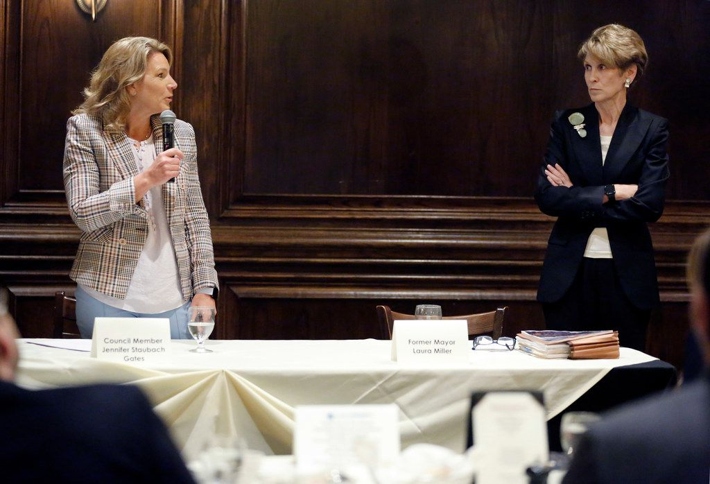 Former Dallas Mayor Laura Miller (right) listens to  Dallas City Councilwoman Jennifer Staubach Gates during a debate hosted by Dallas Builders Association at Maggiano's Little Italy - NorthPark in Dallas, Thursday, April 4, 2019. The two are vying for the District 13 seat held by Gates. (Tom Fox/The Dallas Morning News