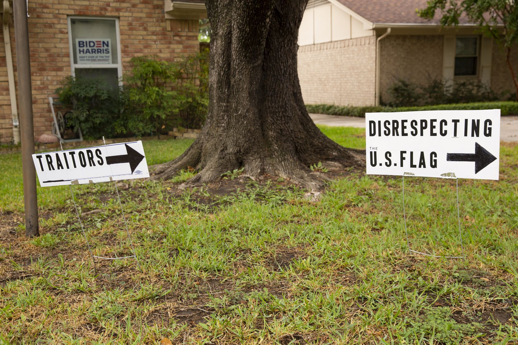 Signs put outside of Brenda Drevicky's home in response to her neighbor putting up signs supporting Trump on Sept. 10, 2020 in Farmers Branch. (Juan Figueroa/ The Dallas Morning News)