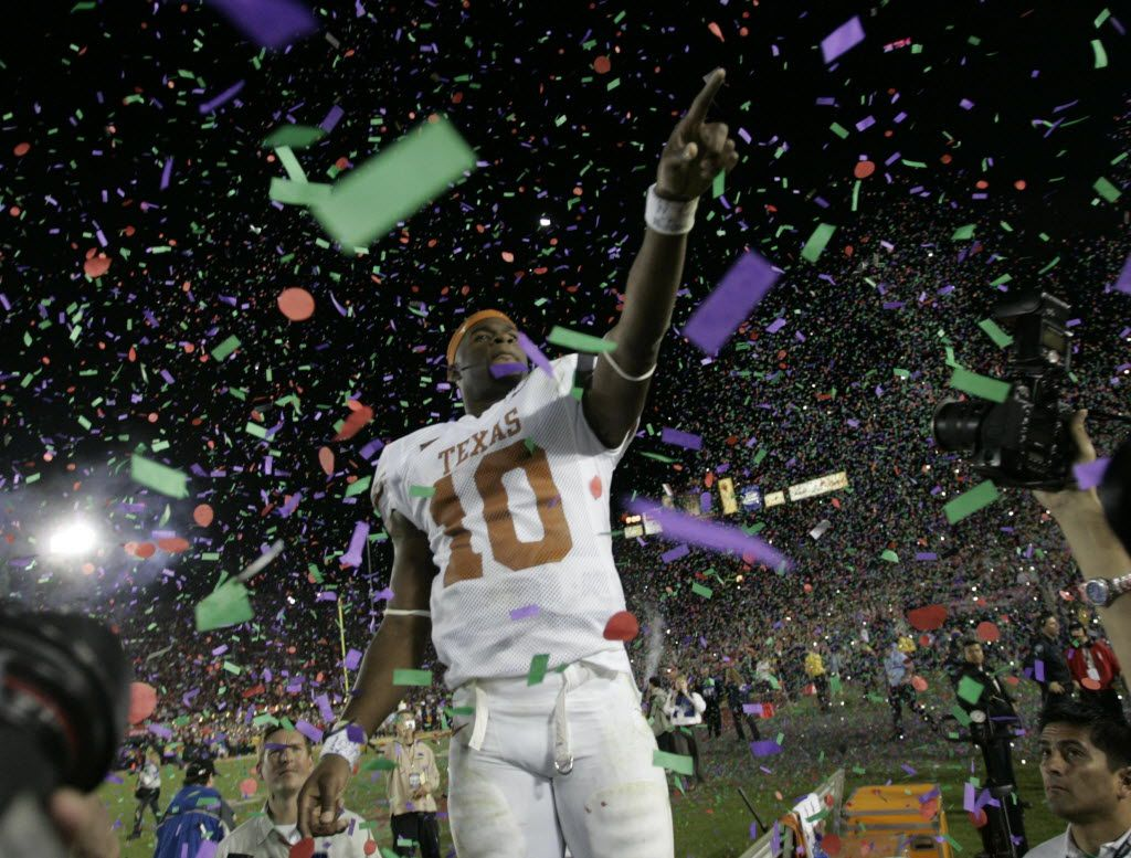 Texas quarterback Vince Young celebrates Texas beat Southern California 41-38 in the Rose Bowl college football game Wednesday, Jan. 4, 2006, in Pasadena, Calif. (AP Photo/The Dallas Morning News, Erich Schlegel)