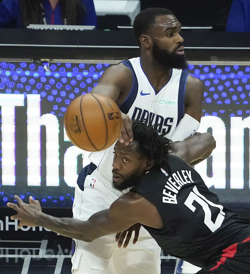 Dallas Mavericks forward Tim Hardaway Jr. (11) tangles with LA Clippers guard Patrick Beverley (21) during the first half of an NBA playoff basketball game at Staples Center on Tuesday, May 25, 2021, in Los Angeles.
