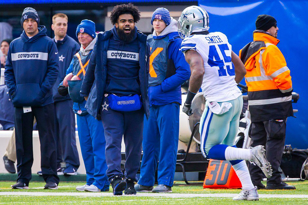 Dallas Cowboys running back Ezekiel Elliott cheers teammate Rod Smith (45) from the sidelines during the first half of an NFL football game against the New York Giants at MetLife Stadium on Sunday, Dec. 30, 2018, in East Rutherford, New Jersey. (Smiley N. Pool/The Dallas Morning News)