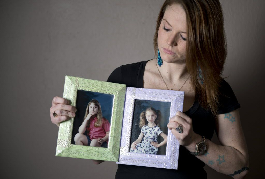 Christie Battaglia, daughter of convicted murderer John Battaglia, holds up photos of her two half-sisters, Faith, left, and Liberty. John Battaglia killed Faith,9, and Liberty,6, in 2001 in his Dallas apartment while their mother listened on the phone. Christie Battaglia, a daughter from John's previous marriage, now resides in Baton Rouge, La.