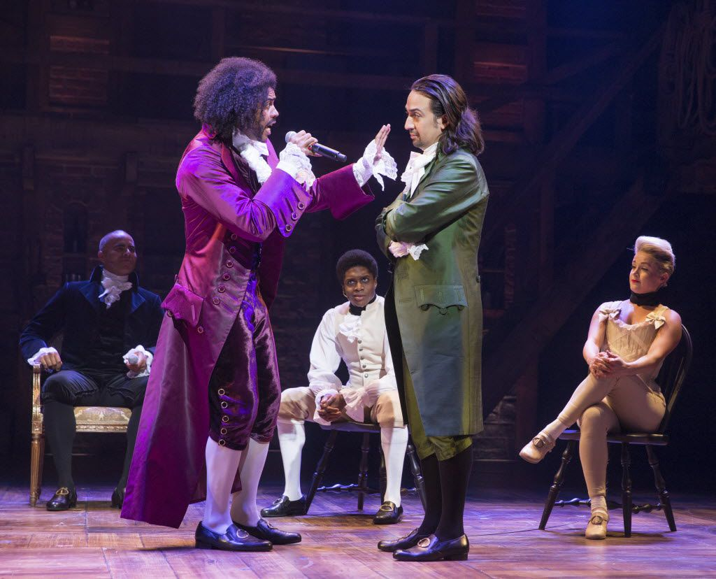 """Daveed Diggs, left, Lin-Manuel Miranda and other cast members in Miranda's musical """"Hamilton,"""" at the Richard Rodgers Theater in New York."""