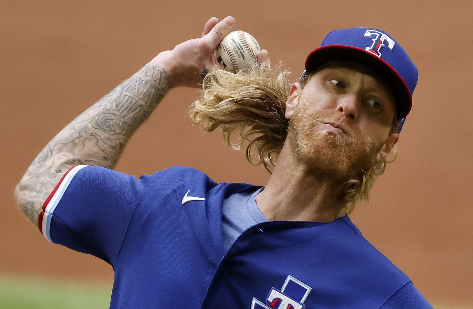 Texas Rangers starting pitcher Mike Foltynewicz (20) throws against the Milwaukee Brewers in the third inning at Globe Life Field in Arlington, Texas. The teams were playing in an exhibition game, Tuesday, March 30, 2021. (Tom Fox/The Dallas Morning News)