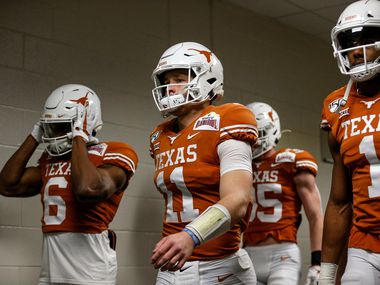 SAN ANTONIO, TX - DECEMBER 31:  Sam Ehlinger #11 of the Texas Longhorns leads the team out of the tunnel before the Valero Alamo Bowl against the Utah Utes at the Alamodome on December 31, 2019 in San Antonio, Texas.  (Photo by Tim Warner/Getty Images)
