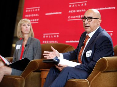 """In this file image, Garland Superintendent Ricardo Lopez (right) answers a question during a panel discussion for the Dallas Regional Chamber's """"State of Public Education"""" luncheon."""