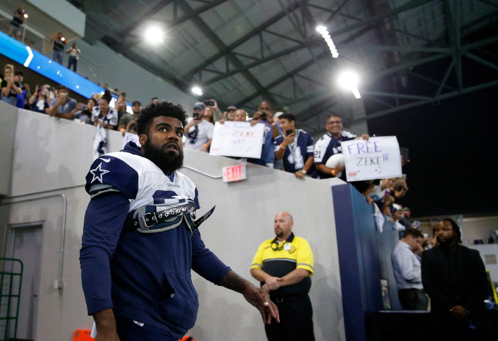 Dallas Cowboys running back Ezekiel Elliott (21) makes his way to the field for practice in the Ford Center during training camp at The Star in Frisco on Monday, August 21, 2017. (Vernon Bryant/The Dallas Morning News)