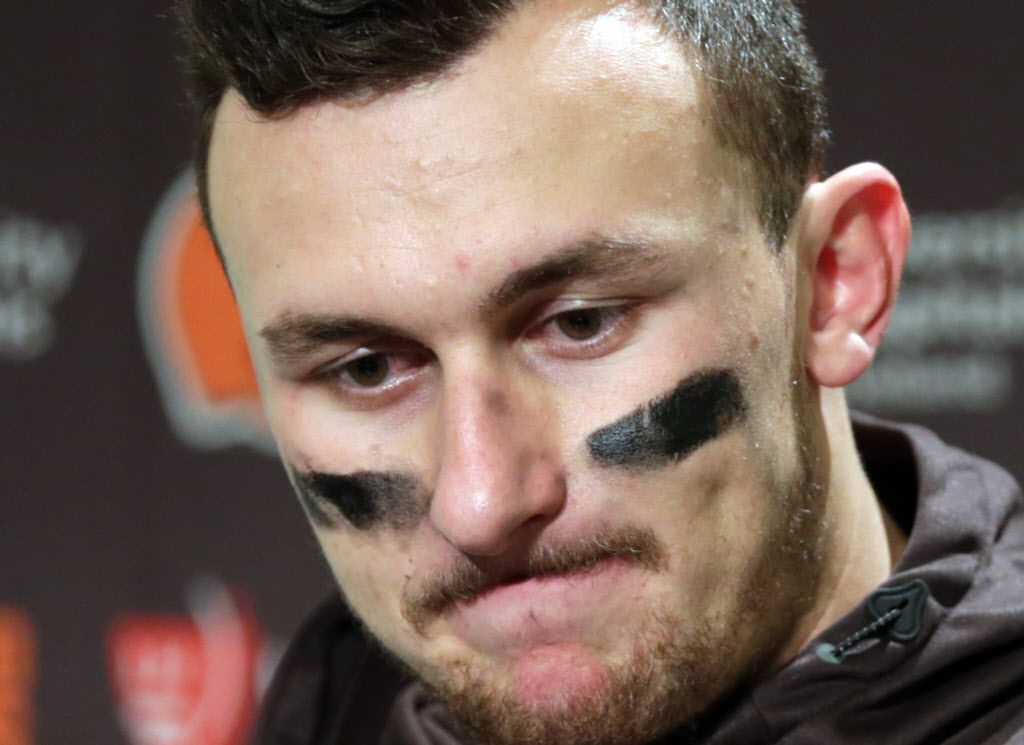 Cleveland Browns quarterback Johnny Manziel speaks with media members following the team's 30-13 loss to the Seattle Seahawks in an NFL football game in Seattle. The Browns said in a statement, Tuesday, Feb. 2, 2016, that Manziel's troubles off the field have undermined his teammates and the organization.