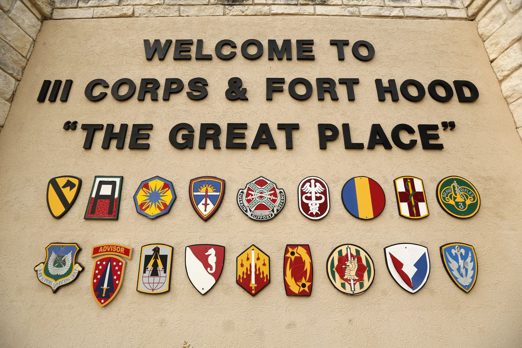 A sign at the Bernie Beck Gate welcomes people to the Fort Hood military base in Killeen, Texas. Soldiers at the base were paid kickbacks in order to request pain creams in a major health care fraud case in Dallas, the government says.