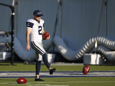 Dallas Cowboys place kicker Greg Zuerlein (2) gathers footballs in practice during training camp at the Dallas Cowboys headquarters at The Star in Frisco, Texas on Thursday, August 20, 2020. (Vernon Bryant/The Dallas Morning News)