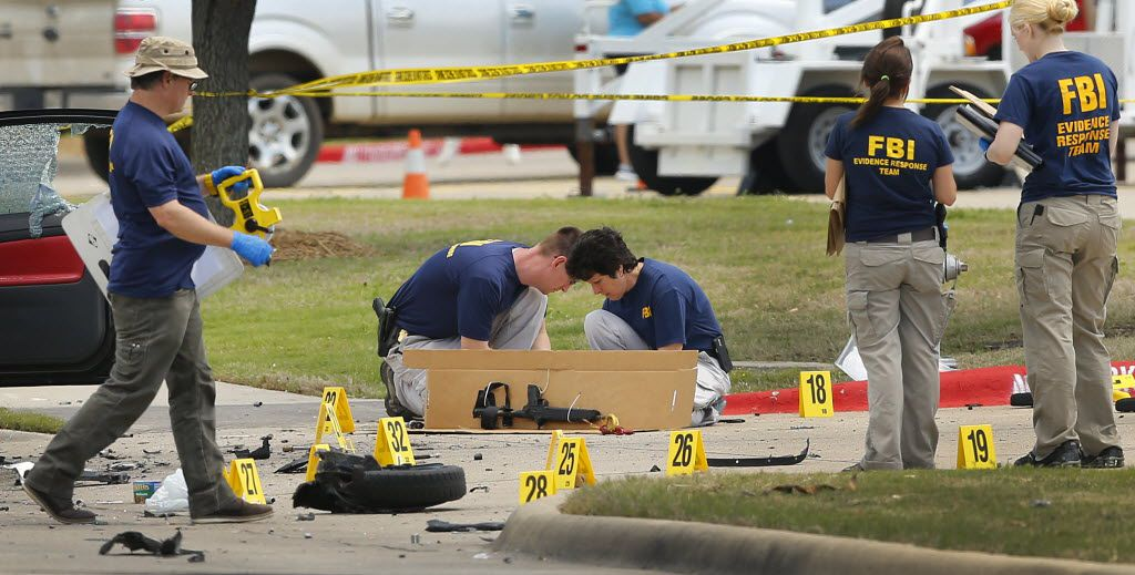 Members of the FBI Evidence Response team box up a  rifle and clip as they document the crime scene on May 4, 2015 outside the Curtis Culwell Center in Garland.