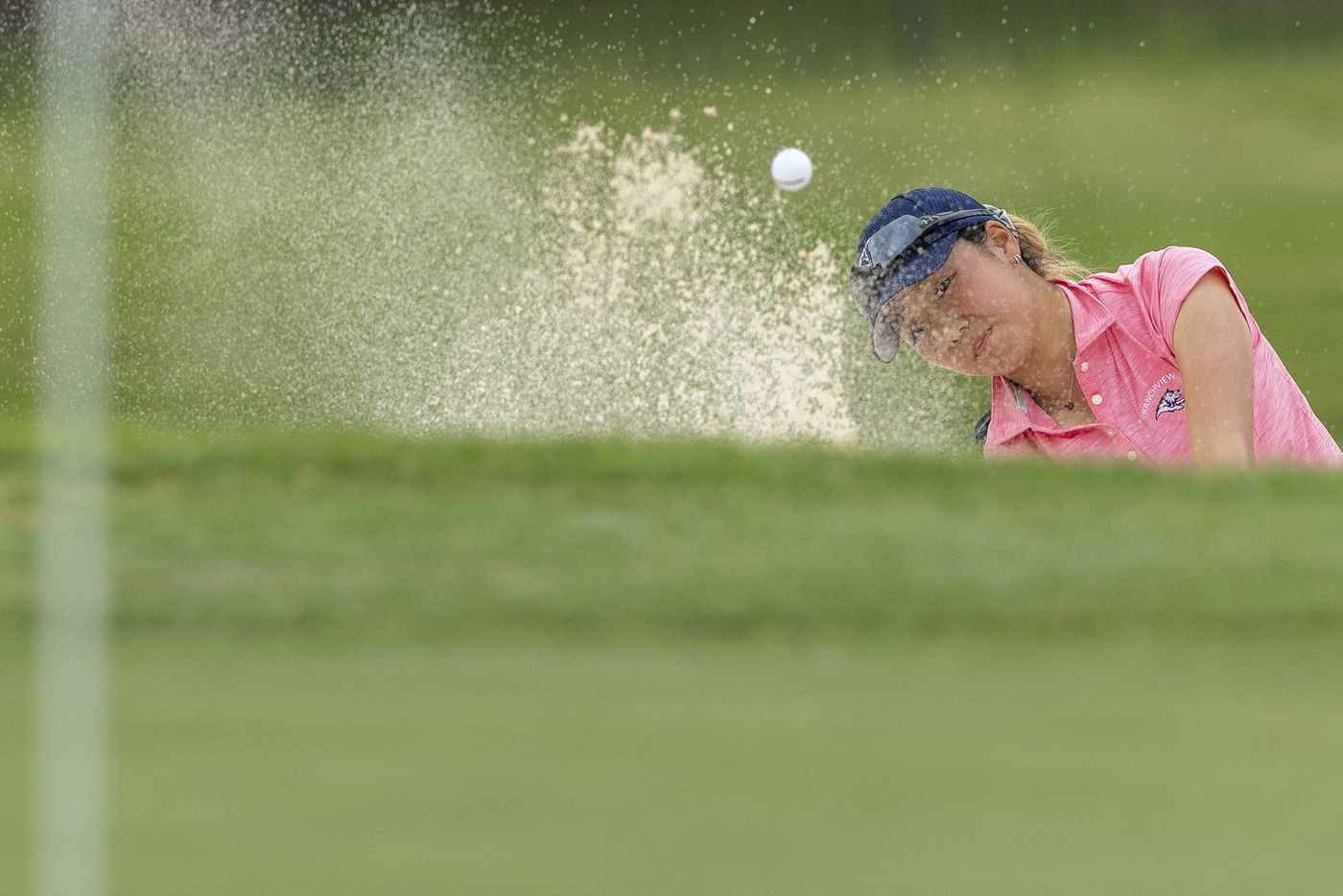 Carrollton Ranchview's Bohyun Park chips on to the 17th green during the final day of the UIL Class 4A girls golf tournament in Kyle, Tuesday, May 11, 2021. (Stephen Spillman/Special Contributor)