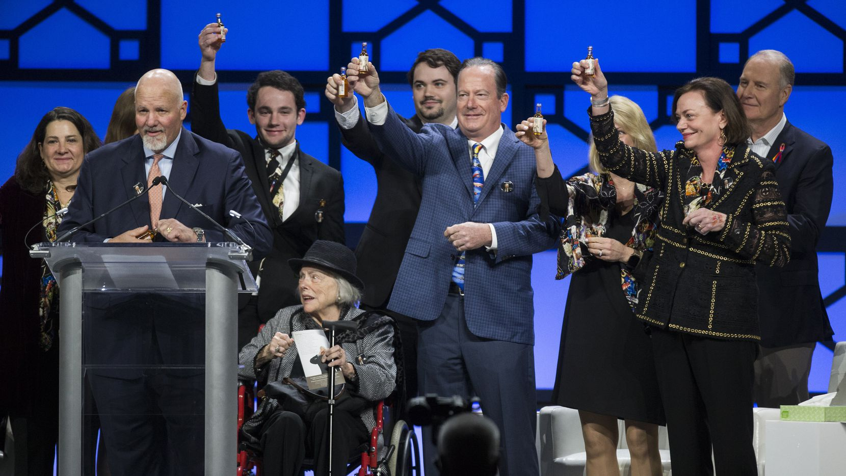 Family members, including wife Joan Kelleher, seated at center, of the late Southwest Airlines co-founder Herb Kelleher raise bottles of Wild Turkey in tribute during a celebration of life event on Tuesday, Jan. 22, 2019 at the Kay Bailey Hutchison Convention Center in Dallas.