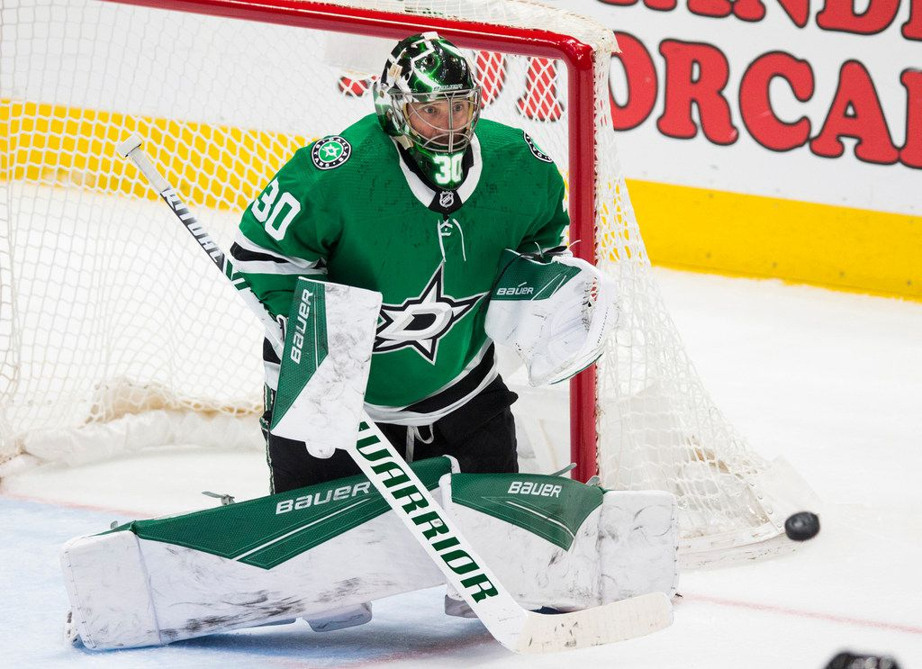 Dallas Stars goaltender Ben Bishop (30) makes a save on a shot by the Buffalo Sabres' Henri Jokiharju during the third period on Thursday, Jan. 16, 2020, at the American Airlines Center in Dallas.