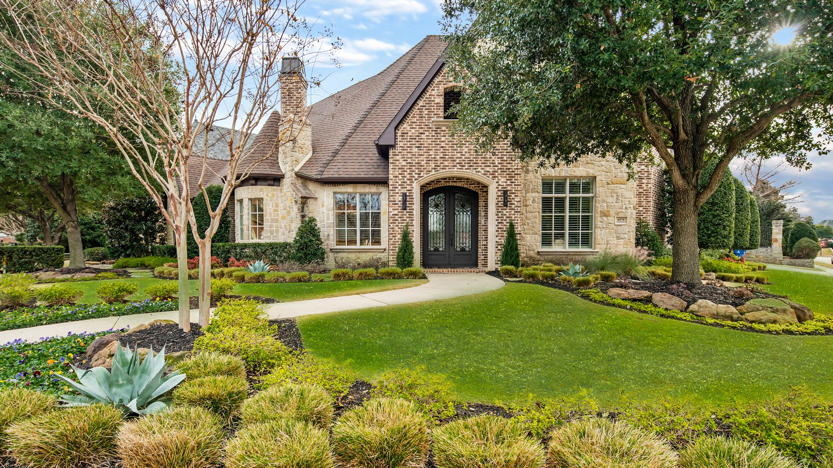 The updated Shelley Reynolds custom estate at 4975 Oak Knoll Lane is offered at $1,399,900.
