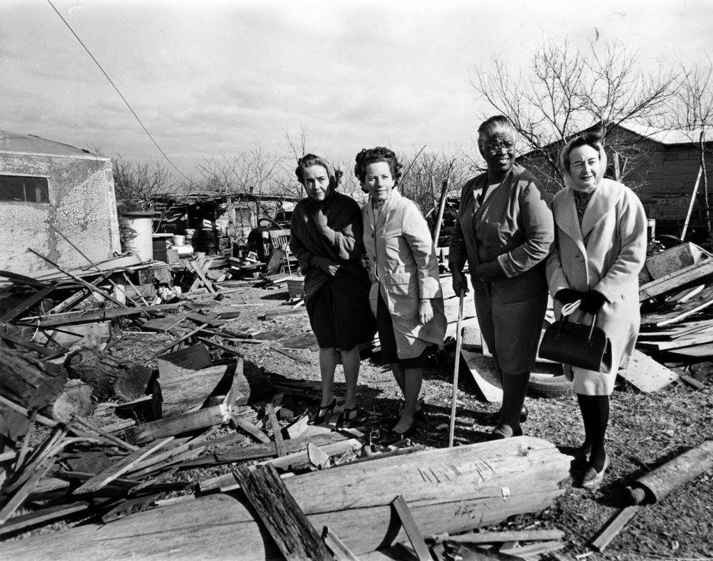 In January 1967, a team of Neighborhood Improvement Program workers examines a yard in South Oak Cliff on Barree Lane. Juanita Craft is second from right.