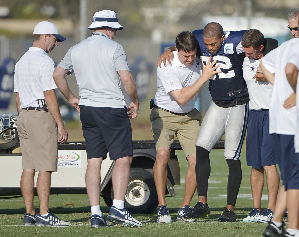 Dallas Cowboys cornerback Orlando Scandrick (32) is placed on a cart after injuring his knee during practice at the team's training camp in Oxnard, Calif., on Tuesday, Aug. 25, 2015. (Max Faulkner/Fort Worth Star-Telegram/TNS)