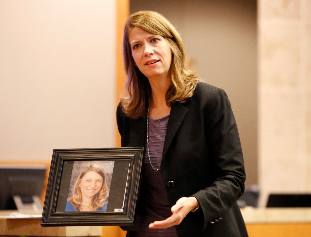 With a photo of Anna Moses in her hand, prosecutor Cynthia Walker delivers closing arguments to the jury in the punishment phase of Robert Moses in the 219th District Court at the Collin County Courthouse in McKinney, Texas, Thursday, November 3, 2016. Moses was found guilty in killing his ex-wife Anna Moses. (Tom Fox/The Dallas Morning News)