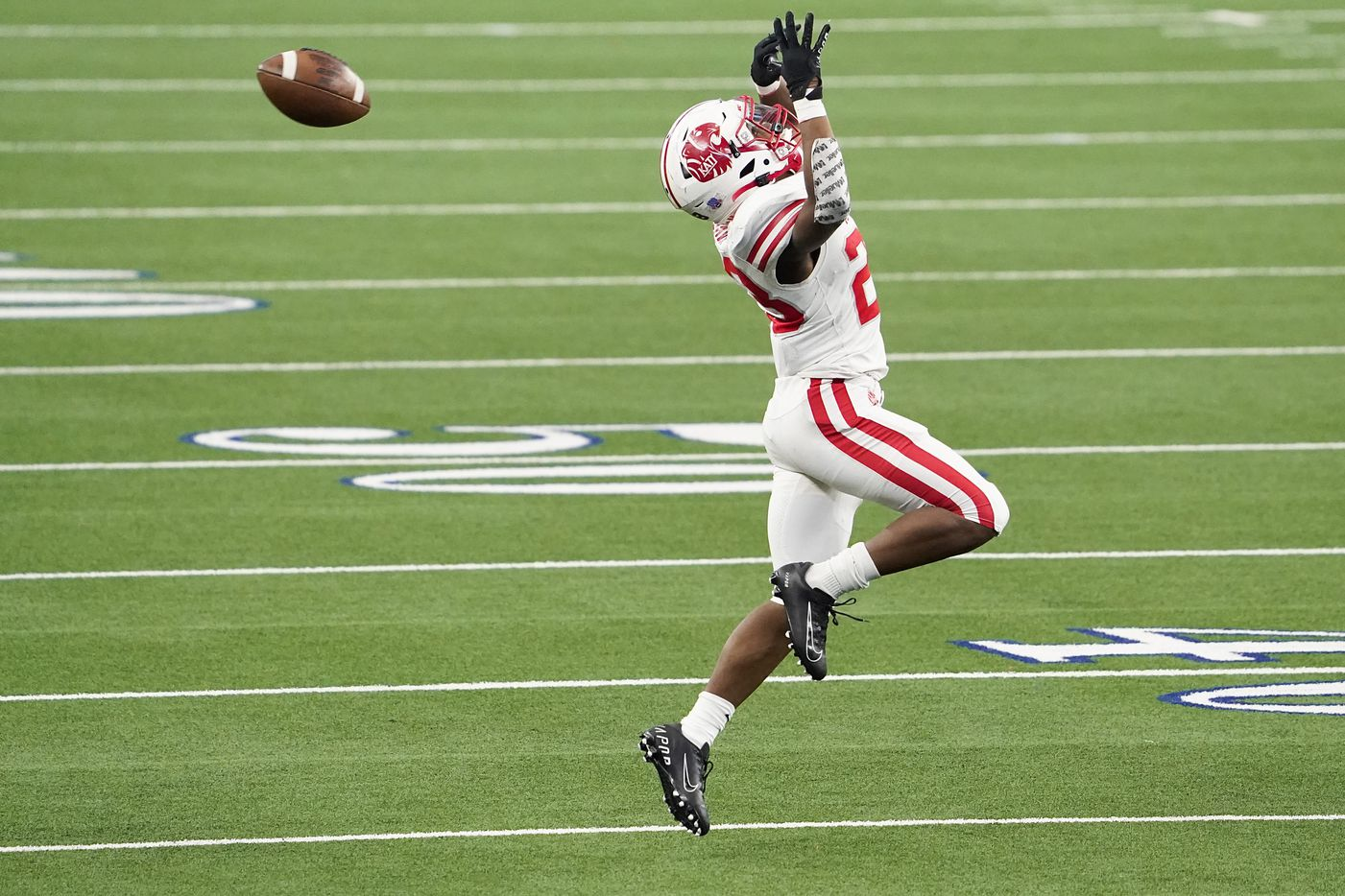 Katy running back Seth Davis (23) has  pass go off his hands during the first half of the Class 6A Division II state football championship game against Cedar Hill at AT&T Stadium on Saturday, Jan. 16, 2021, in Arlington, Texas.