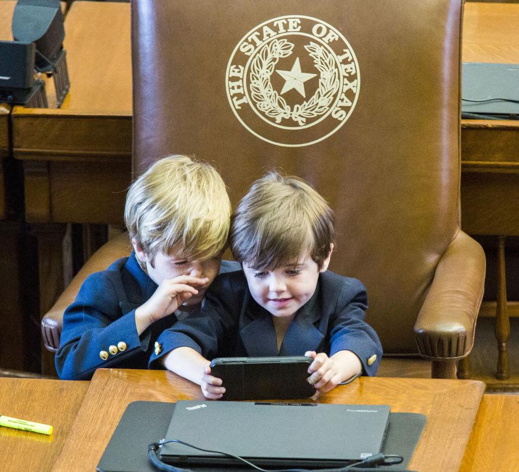 Rep. Dade Phelan's sons  — Ford, 6, and Mack, 5 — played at their dad's desk on Monday, the last day of the session.