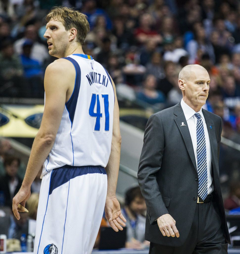 Dallas Mavericks forward Dirk Nowitzki (41) and Dallas Mavericks head coach Rick Carlisle react to a San Antonio Spurs point during the second quarter of their game on Friday, February 5, 2016 at the American Airlines Center in Dallas.  (Ashley Landis/The Dallas Morning News)