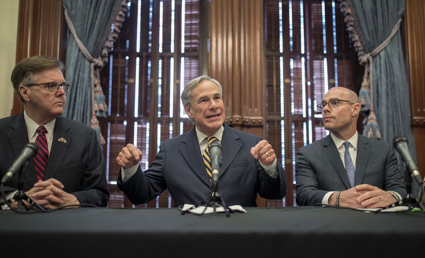 Gov. Greg Abbott announces a deployment of National Guard troops to the Texas-Mexico border at a news conference at the Capitol, Friday June 21, 2019 in Austin, Texas. Listening are Lt. Gov. Dan Patrick, left, and House Speaker Dennis Bonnen.