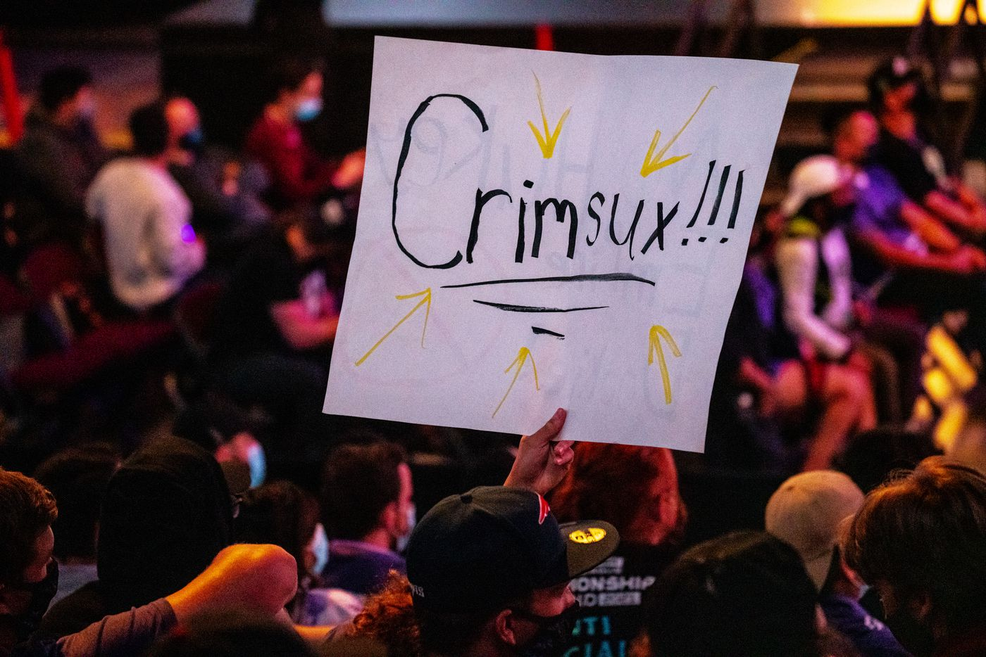 """A spectator holds up a sign belittling the Dallas Empire's Ian """"C6"""" Porter during the Call of Duty league playoffs at the Galen Center on Saturday, August 21, 2021 in Los Angeles, California. The Empire lost to Ultra 2 - 3, eliminating them from the tournament. (Justin L. Stewart/Special Contributor)"""