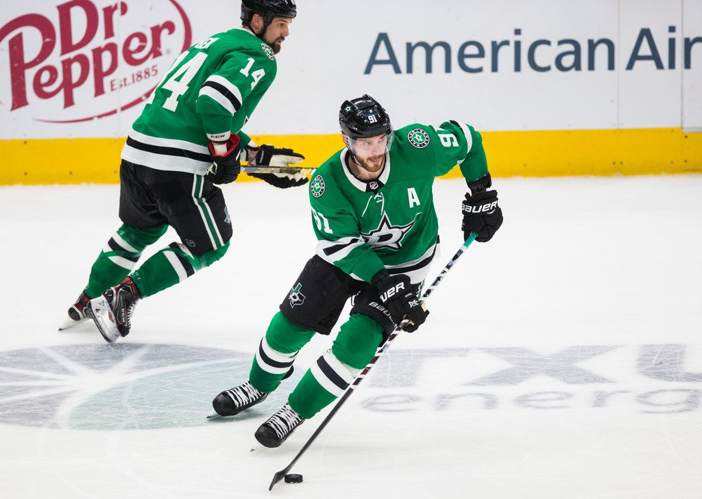 Dallas Stars center Tyler Seguin (91) and left wing Jamie Benn (14) make their way down the ice during the second period of an NHL game between the Dallas Stars and the Carolina Hurricanes on Tuesday, February 11, 2020 at American Airlines Center in Dallas.
